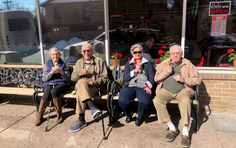 Happy seniors eating ice cream at Eastern Star Masonic Retirement Campus in Denver, CO