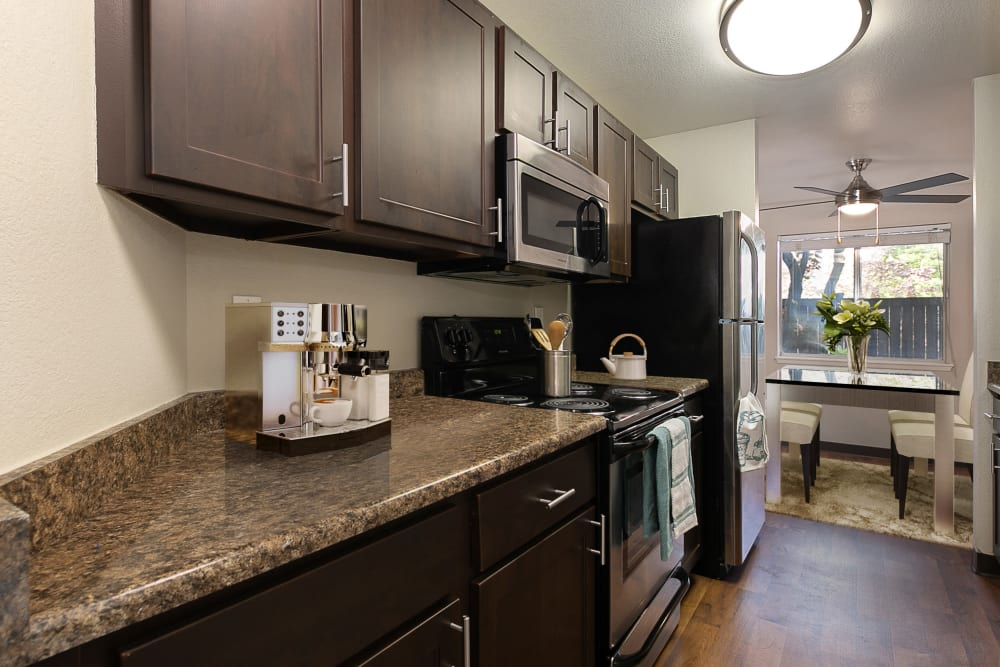 Kitchen with wood-style flooring at Latitude Apartments in Everett, Washington