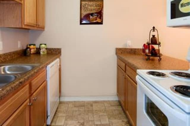 Kitchen room hallway at Summerfield Apartment Homes in Harvey, Louisiana