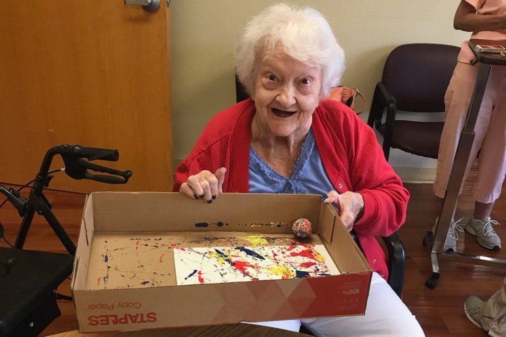 A resident painting at Ashford Place Health Campus in Shelbyville, Indiana