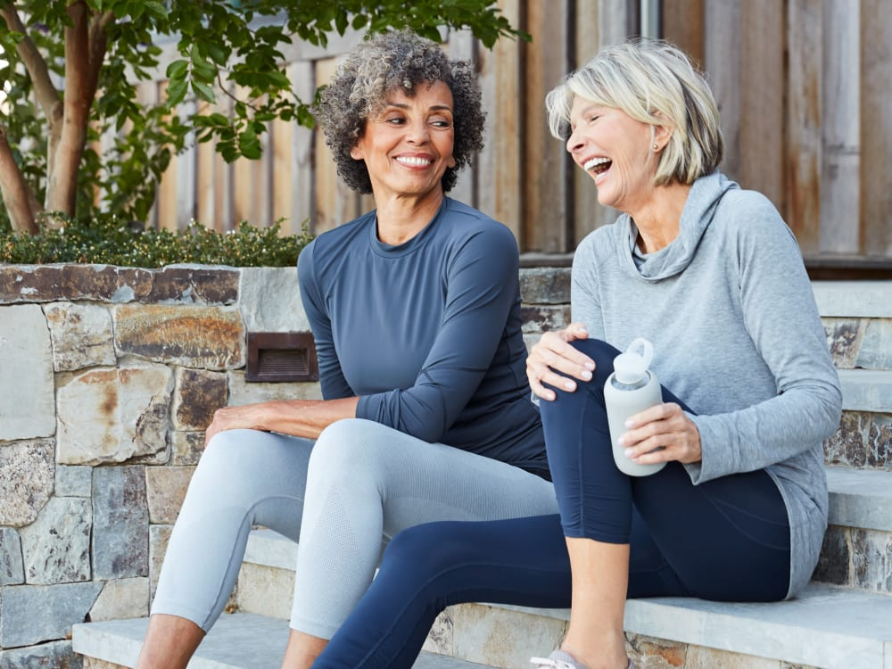 Residents chatting on the stoop outside their home at Harbor Point Apartments in Mill Valley, California