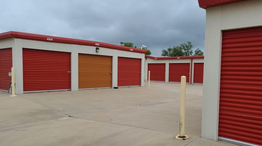 Red and orange storage units at KO Storage of Wichita Falls in Wichita Falls, Texas