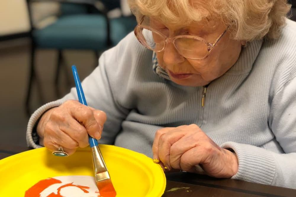 Female resident painting a masterpiece at Springview Manor in Lima, Ohio