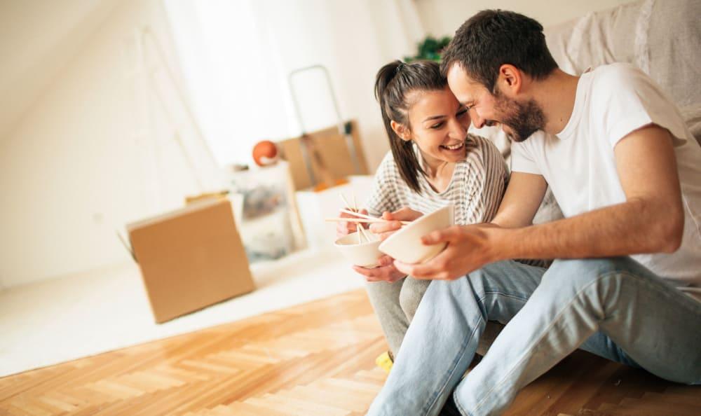 Couple taking a break while moving into their new home near Hallmark Mini Storage