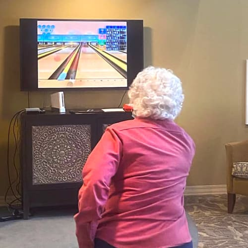 Resident video bowling at The Oxford Grand Assisted Living & Memory Care in Kansas City, Missouri