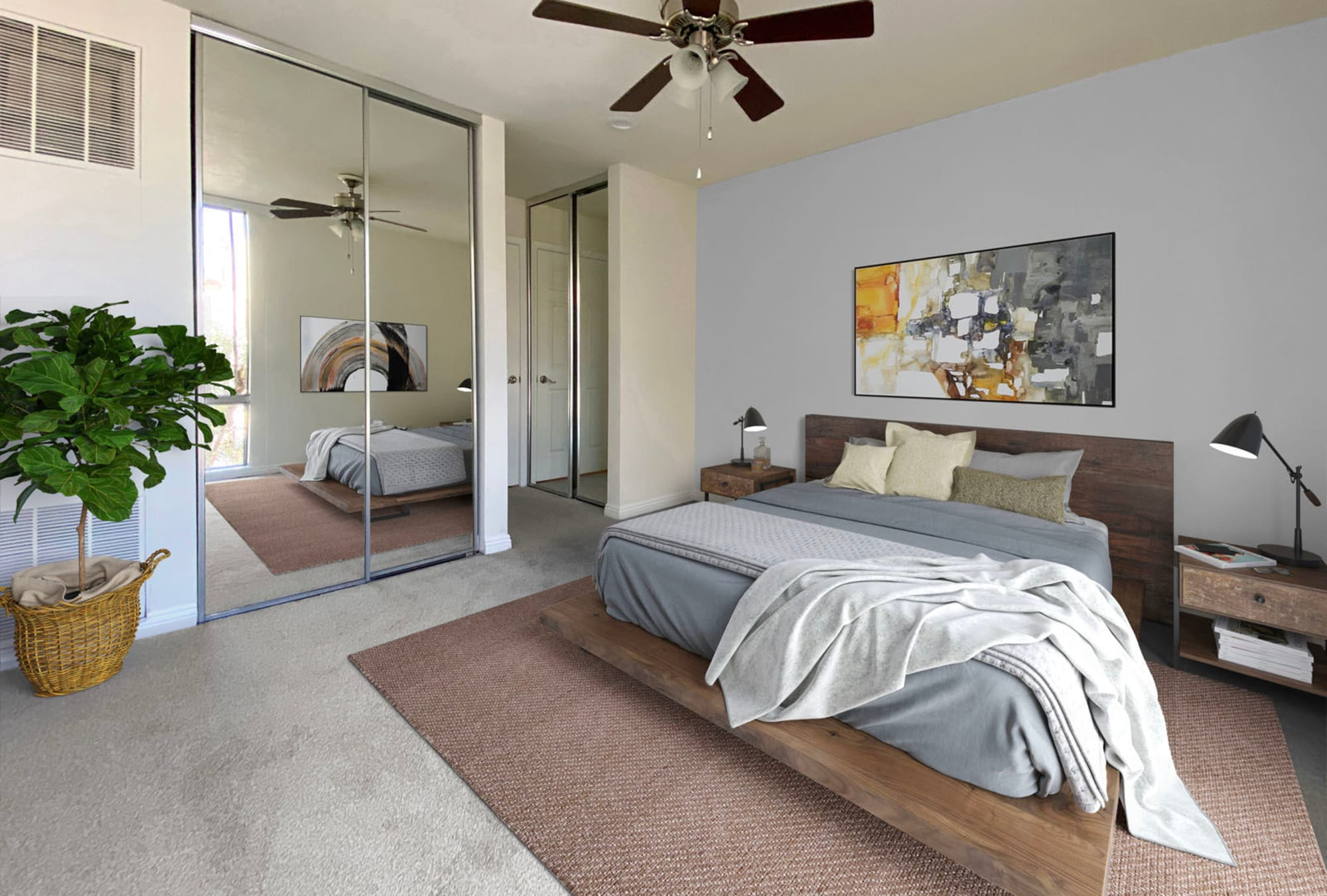Mirrored closet doors and plush carpeting in a model home's bedroom at Mediterranean Village in West Hollywood, California