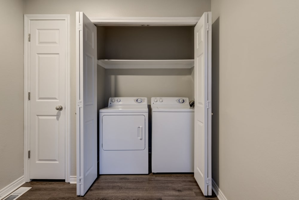 Full size washer and dryer with additional storage space at Ashford Belmar in Lakewood, Colorado