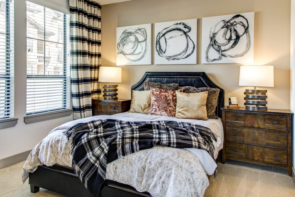Modern furnishings in the bedroom of a model home at Waterford Trails in Spring, Texas