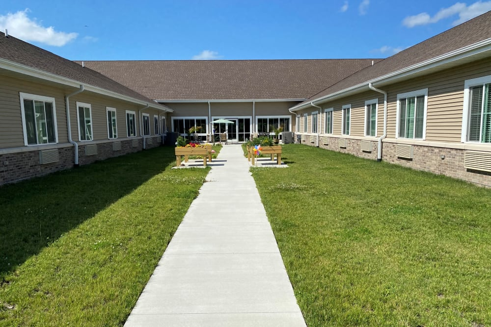 Enclosed courtyard with walking path at Country Meadow Place in Mason City, Iowa