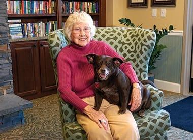 Resident and her dog at Burr Ridge Senior Living in Burr Ridge, IL