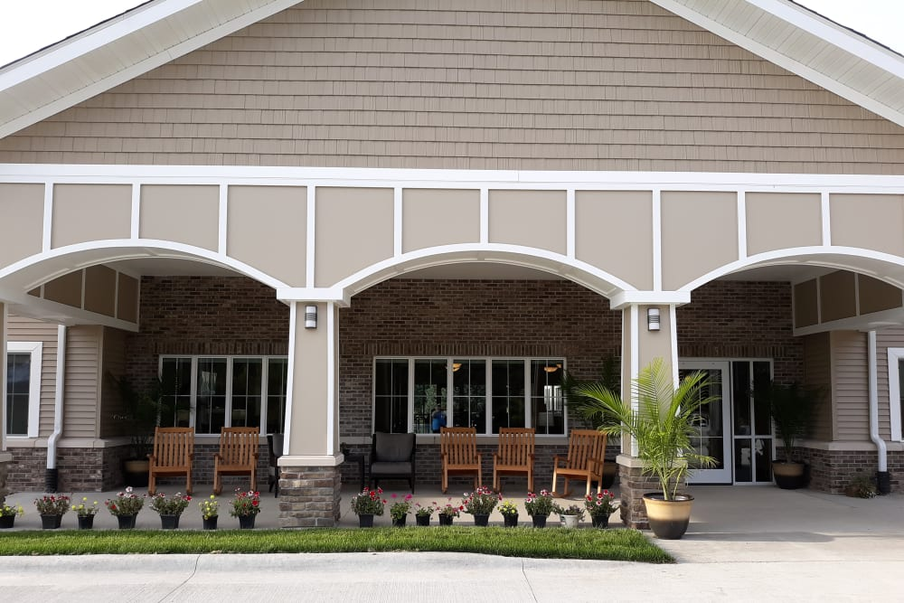 Outdoor covered sitting area with rocking chairs at Country Meadow Place in Mason City, Iowa