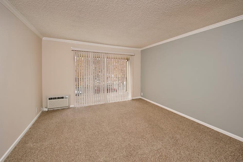 Spacious room with sliding glass door at Flora Condominium Rentals in Walnut Creek, California