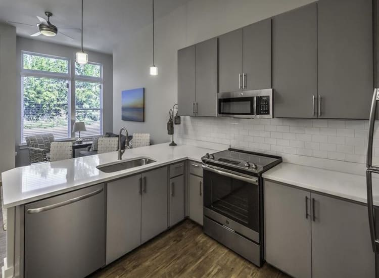Fully-equipped kitchen at 300 Optimist Park in Charlotte, North Carolina