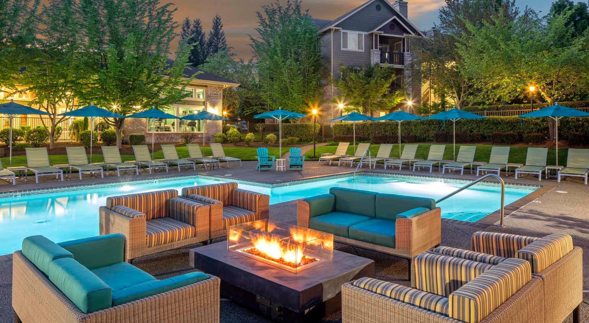 The Grove at Orenco Station features a relaxing pool and fire pit, in Hillsboro, Oregon