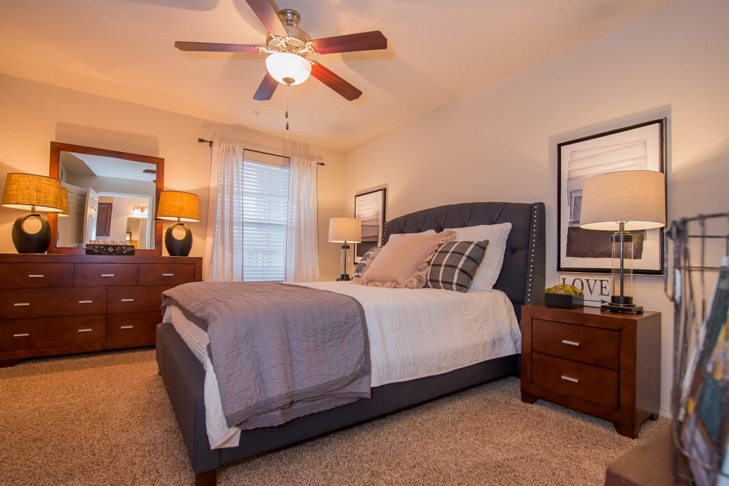 Bedroom with a ceiling fan at The Park on Westpointe in Yukon, Oklahoma