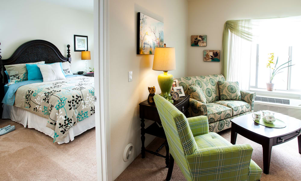 Apartment living room leading to the bedroom at Fairview Estates Gracious Retirement Living in Hopkinton, Massachusetts