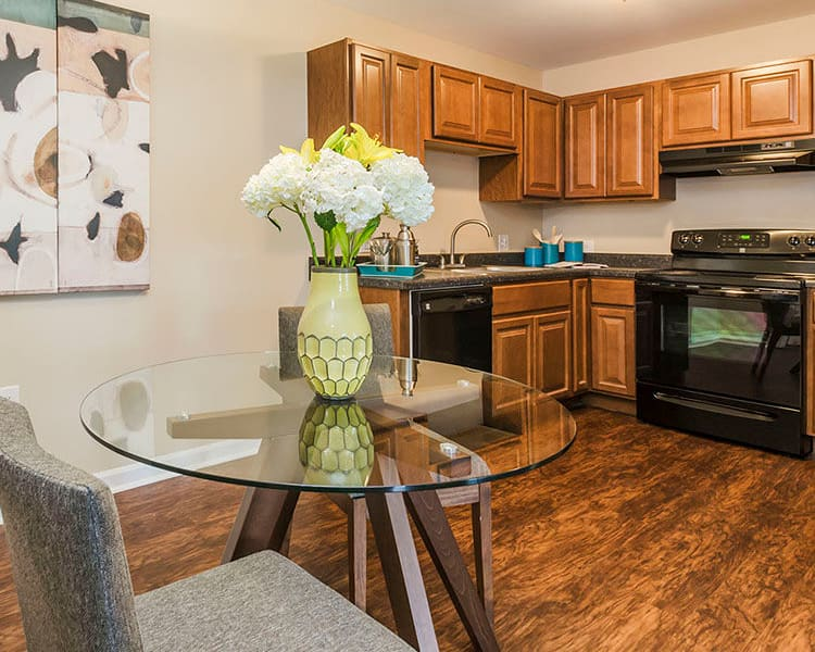 Modern kitchen in model apartment home at The Lakes at 8201 in Merrillville, Indiana