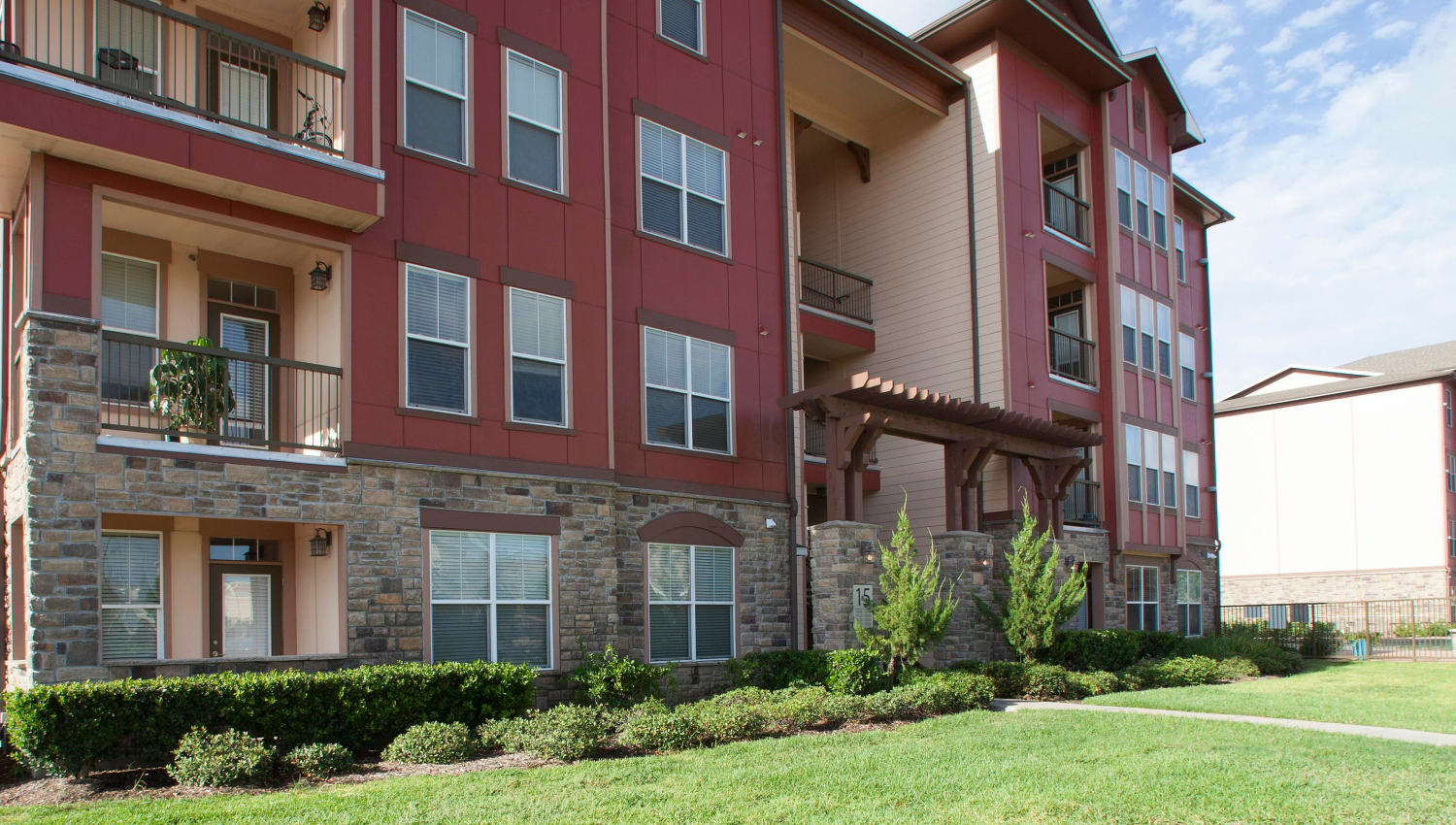Resident building overlooking one of the expansive lawn areas at Olympus Katy Ranch in Katy, Texas