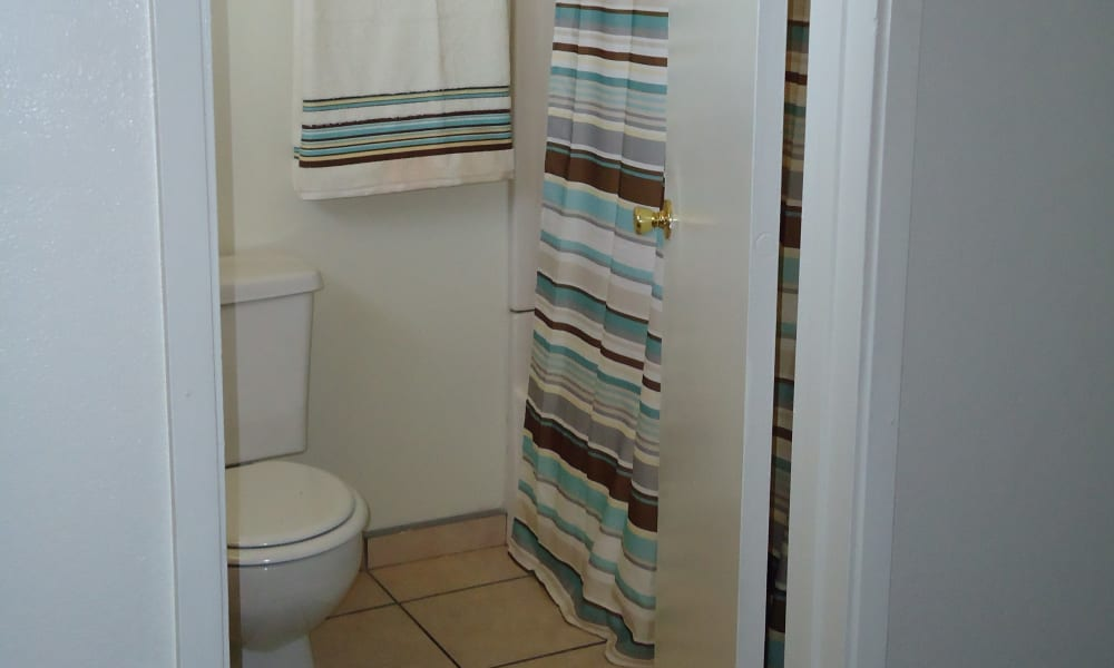 Modern bathroom at Olympus Court Apartments in Bakersfield, California