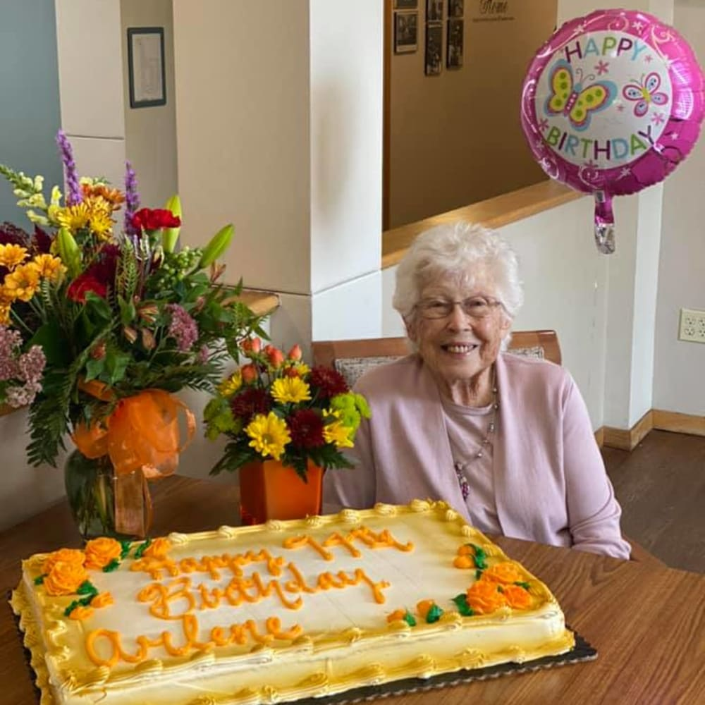 Resident and birthday cake and flowers at Glenwood Place in Marshalltown, Iowa.
