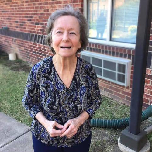 Resident standing outside at Canoe Brook Assisted Living & Memory Care in Catoosa, Oklahoma