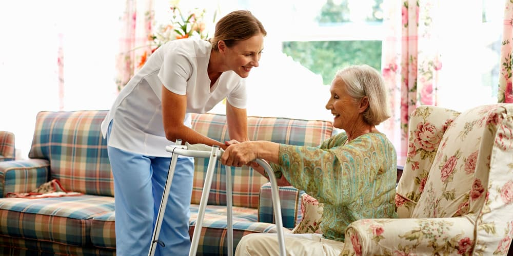 A staff member helping a resident at Careage in Gig Harbor, Washington.