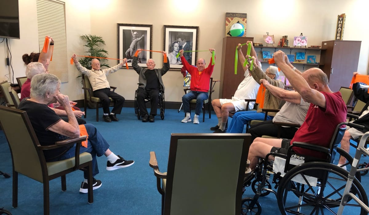Residents stretching at CERTUS Premier Memory Care Living in Mount Dora, Florida.