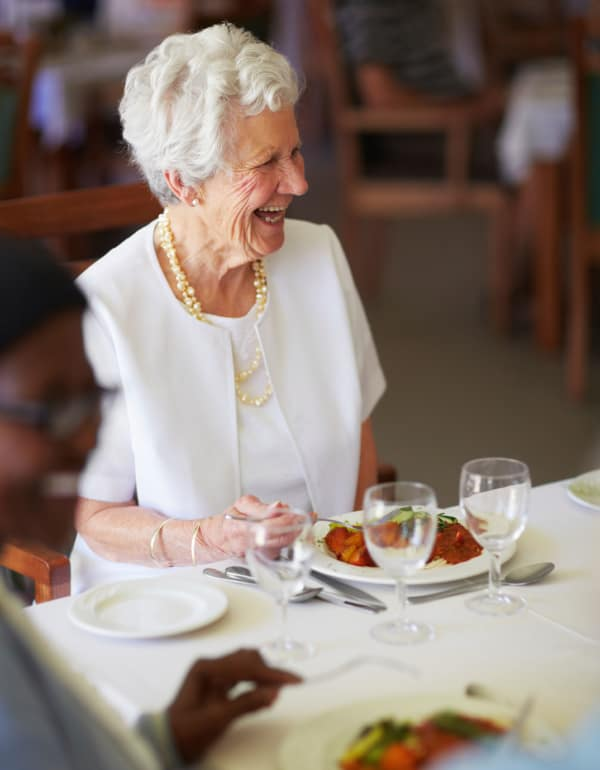 Resident enjoying dinner at The Phoenix at Lady's Island in Beaufort, South Carolina