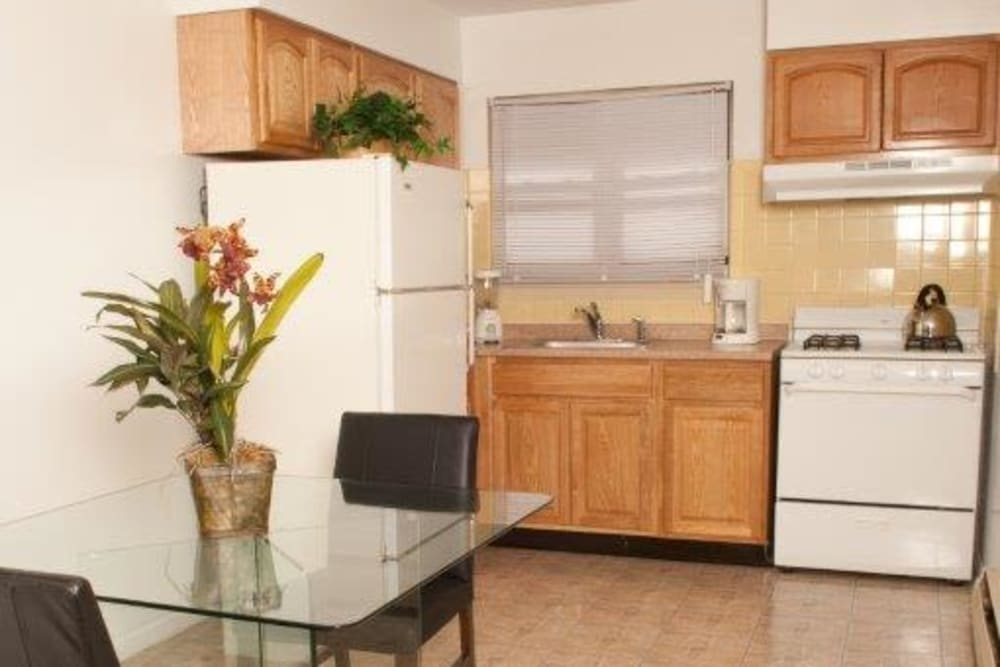 Kitchen with white appliances at Lynn York Apartments in Irvington, New Jersey