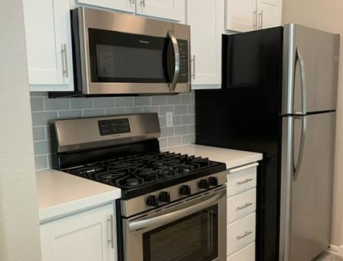 Modern kitchen with stainless steel appliances at Laguna Creek Apartments in Elk Grove, California