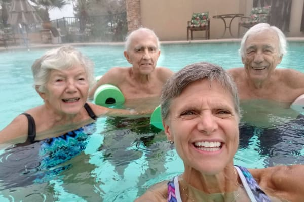 Residents in the pool at Mulligan Park Gracious Retirement Living in Tallahassee, Florida
