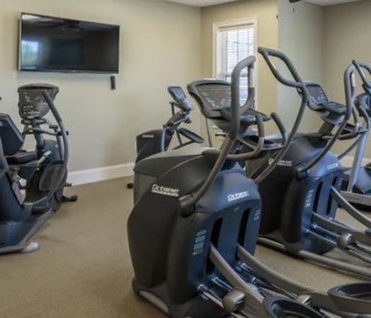 Fully equipped fitness center at Auburn Creek Apartments in Victor, New York