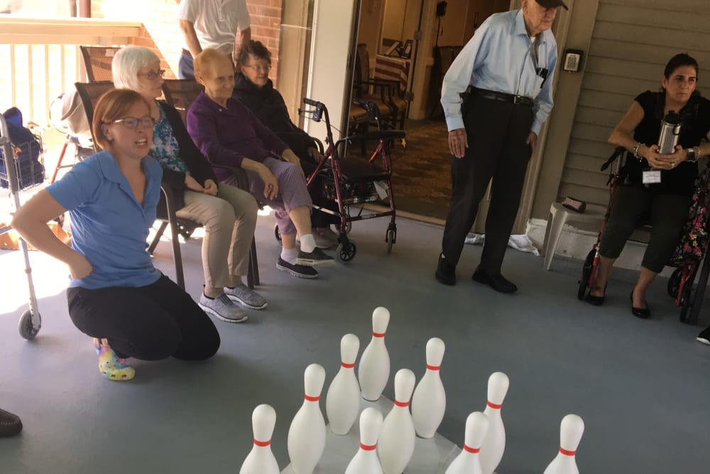 Residents and staff playing a bowling game at Smithfield Woods in Smithfield, Rhode Island