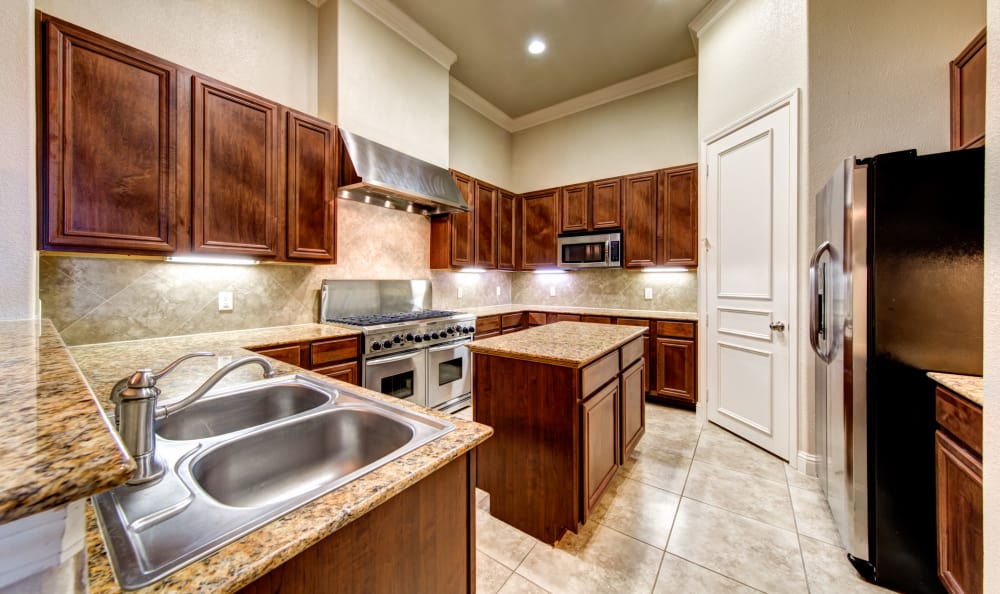 Spacious kitchen in our San Antonio, TX apartments - Breakfast bar at apartments in