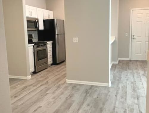 View of entry and modern kitchen at Laguna Creek Apartments in Elk Grove, California