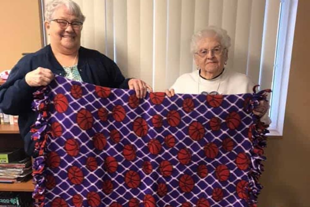 Residents display a blanket they made at Lawton Senior Living in Lawton, Iowa.