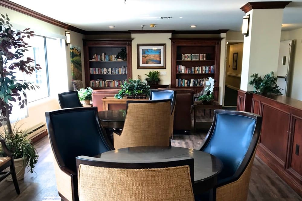 Confortable dinning area with at the library at Pacifica Senior Living San Leandro in San Leandro, California