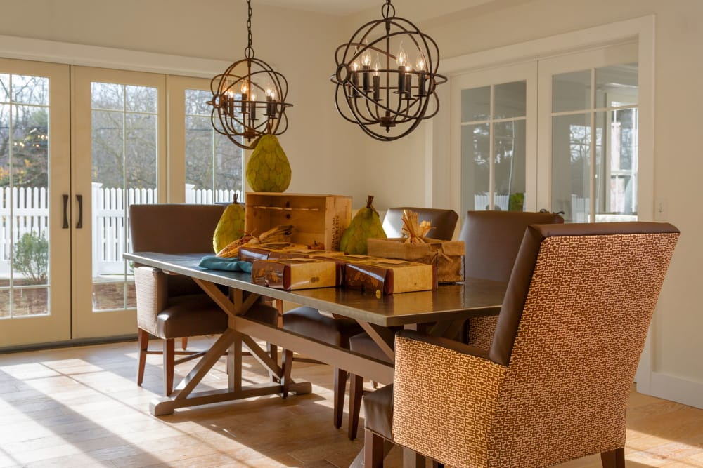Table with decorative light fixtures at Maplewood at Darien in Darien, Connecticut