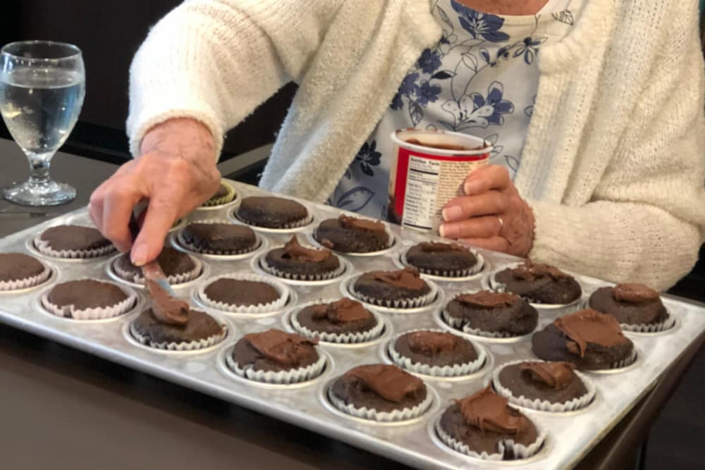 Senior resident decorating cupcakes at Genoa Retirement Village in Genoa, Ohio