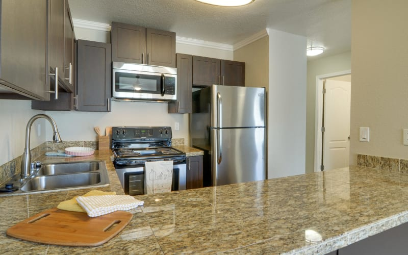 Renovated kitchen with stainless-steel appliances at Carriage House Apartments in Vancouver, Washington
