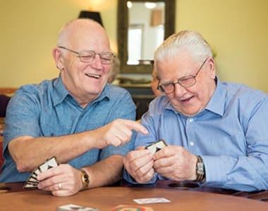 Seniors having fun playing cards at Las Soleras Senior Living in Santa Fe, NM