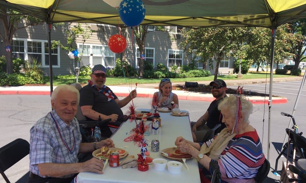 Residents enjoying a party outside at Woodside Senior Living in Springfield, Oregon