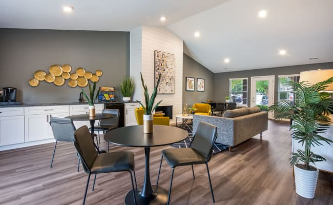 Contemporary clubhouse with plenty of seating at Sharon Pointe Apartment Homes in Charlotte, North Carolina