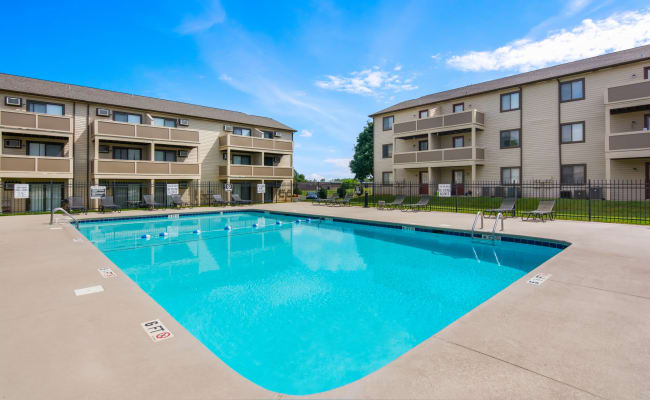 Swimming pool with an expansive sundeck at Gable Oaks Apartment Homes in Rock Hill, South Carolina