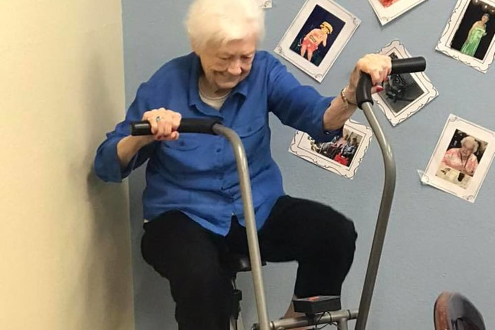 A resident exercising at Oak Pointe of Warrenton in Warrenton, Missouri