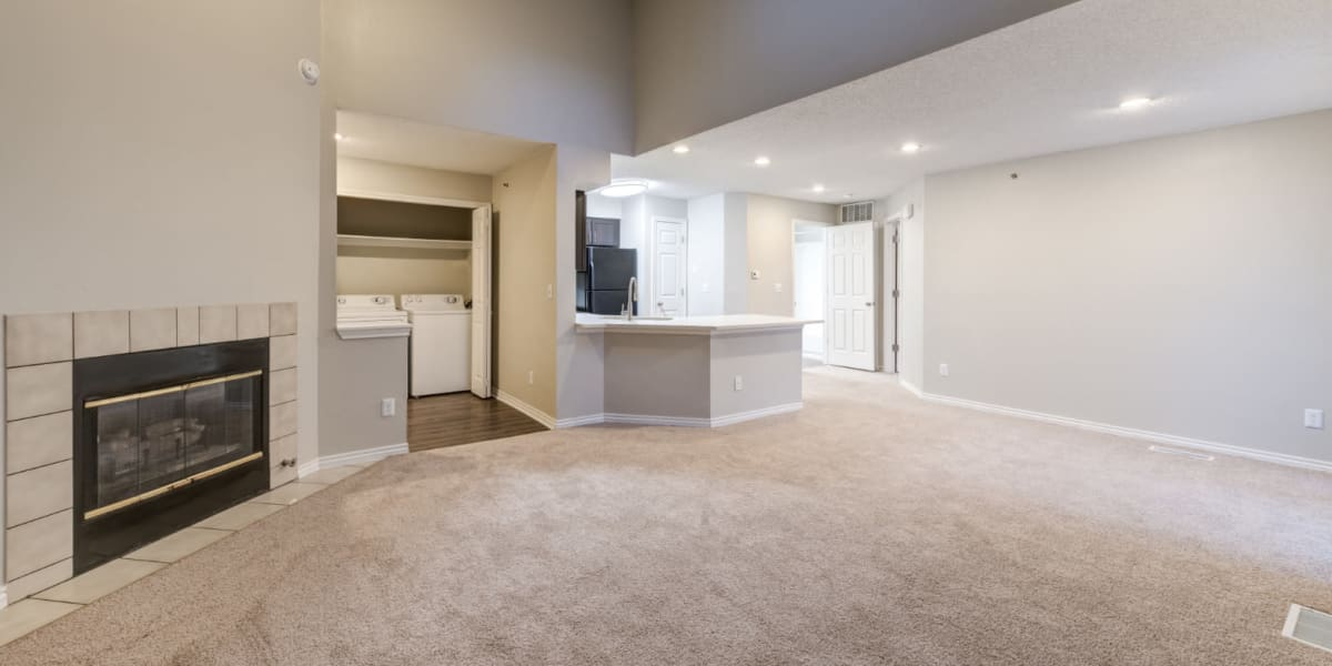Carpeted living area with skylight and laundry closet at Ashford Belmar in Lakewood, Colorado