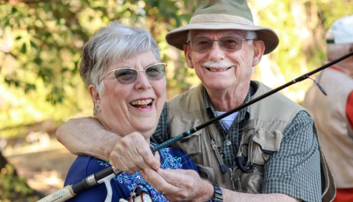 Residents smiling and fishing at The Springs Living in McMinnville, Oregon