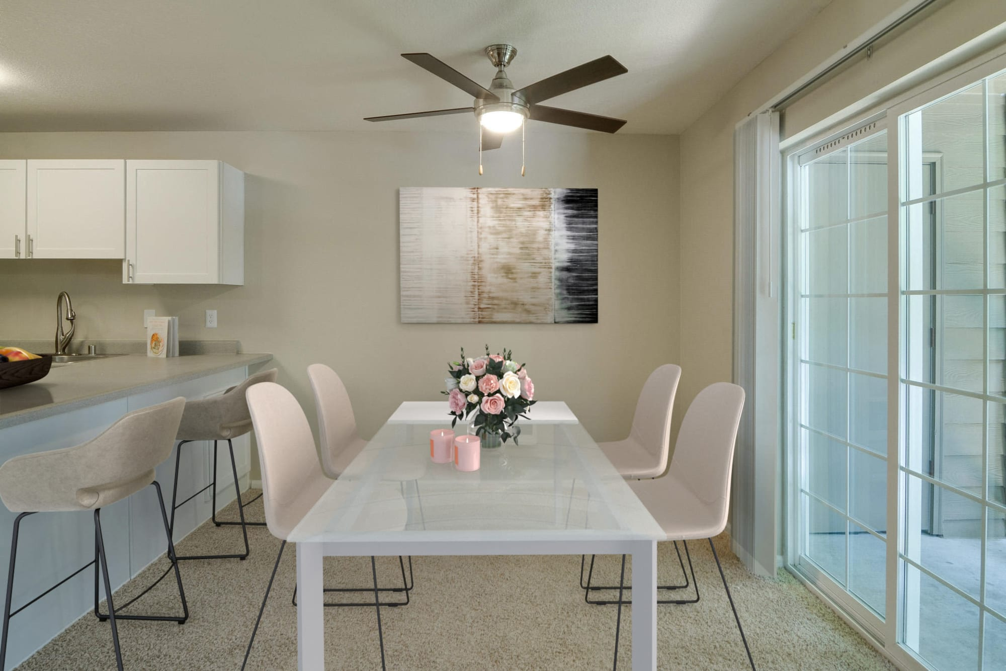 Dining room with a ceiling fan at Carriage House Apartments in Vancouver, Washington