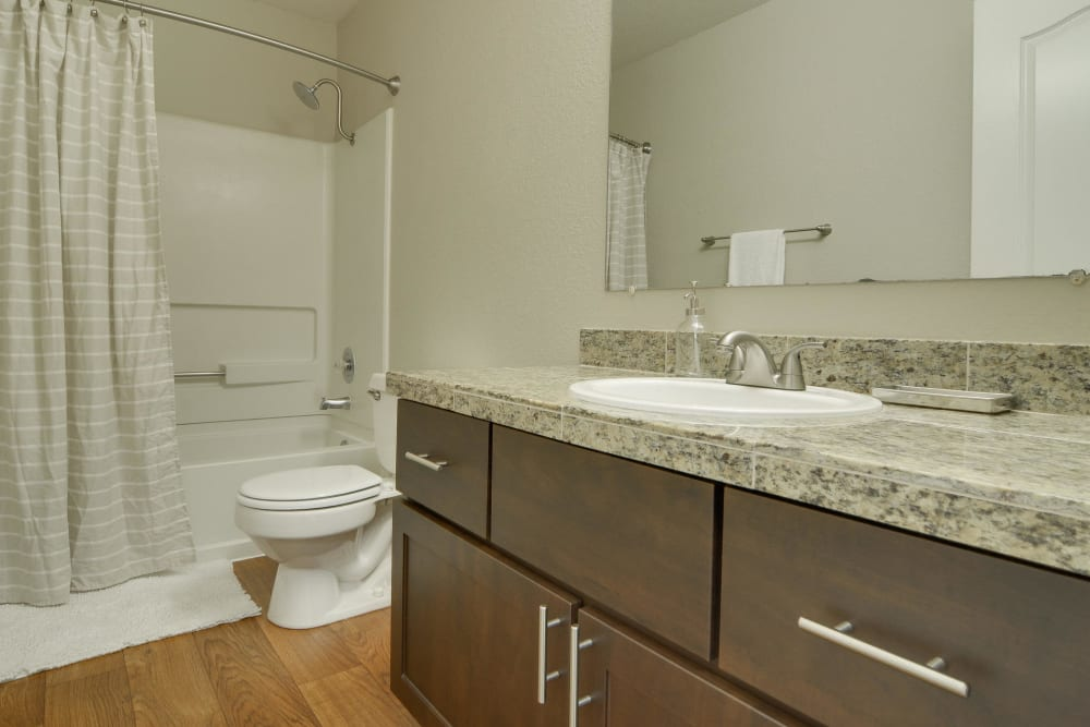 Bathroom with fashionable counter tops and cabinets at Carriage House Apartments in Vancouver, Washington
