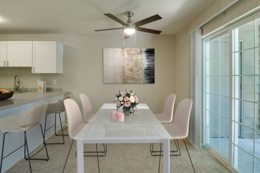 Dining room, kitchen and patio doors at Carriage House Apartments in Vancouver, Washington